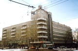 Apartment building with a clock in Novosibirsk