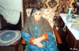 Elderly Russian woman in her apartment in the village of Tushino