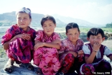 Village girls in Kyrgyz traditional dresses in the Fergana Valley