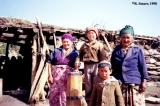 Kyrgyz family with a butter churn in front of a shepherd's dwelling (kosh), Aksu Valley