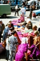 Uzbek women selling and buying textiles at a market in Samarkand