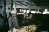 Kyrgyz man selling fruit at a market in Tashkent