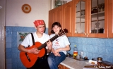 Young people playing guitar and singing in a kitchen in Irkutsk