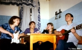 Family singing in a kitchen in their apartment in Irkutsk
