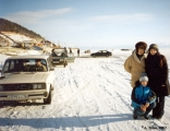 Cars driving on frozen and snow-covered Lake Baykal
