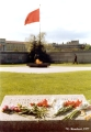 Eternal flame and flowers on a monument to fallen revolutionaries on the Field of Mars in Saint...