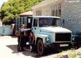 Karachay businessman with his daughter and a truck in the village of Dzhingirik
