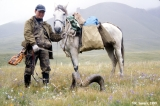 Kazakh hunter with Marco Polo sheep horns in the Dzhaak Valley