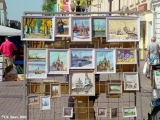 Artist's stand with paintings offered for sale on the Arbat Street in Moscow