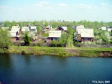 Dachas by a river in Siberia