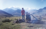 Karachay family making a bonfire at the site of the Narzan geysers, with Mount Elbrus in the...