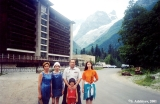 Karachay family in front of the Mountain Heights Hotel  in Dombay,  with Mount Zub (Tooth)...