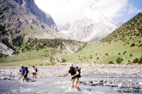 Hikers crossing the Ortho Chashma River