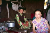 Kyrgyz family inside their shepherd dwelling (kosh) in the Aksu Valley