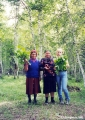 Birch grove and women from a village of Russian Orthodox Old Believers outside Ulan-Ude