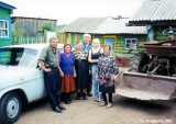 Family in front of their car in a village of Russian Orthodox Old Believers outside Ulan-Ude