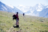 Hikers on Tekeliu Ridge of Mount Belukha, Altai Mountains