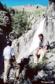 Hikers by a waterfall, upper Tekeliu River, Altai Mountains