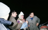 Krapivna villagers going door to door on New Year's Eve and singing carols