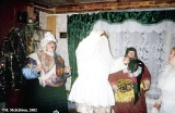 Dressed up Krapivna villagers dancing in a home on New Year's Eve before they set off singing...