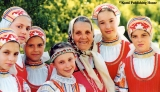Young girls with an older woman in traditional Komi costumes