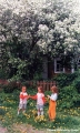 Girls playing outside a farm house in the Komi Republic