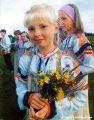 Girl in a traditional Komi costume holding flowers