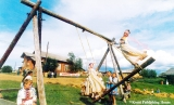 Girls in traditional costumes on swings in the Komi Republic