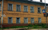 "Apartment building in Arkhangelsk with a sign ""Thirty-six tenants demand decent living..."