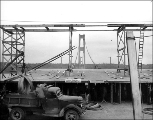 Cable salvaged from the Tacoma Narrows Bridge being loaded into a truck, 1941