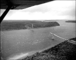Aerial view of the Tacoma Narrows Bridge and the Tacoma narrows after the collapse, November 8,...