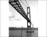 Underside of the roadway of the Tacoma Narrows Bridge during salvage operations, December 1940