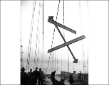 Girders being removed from the collapsed Tacoma Narrows Bridge during salvage operations, January...