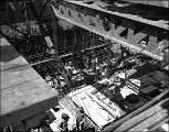 Men working in the interior of caisson for the Tacoma Narrows Bridge showing reinforcing rods, ca....