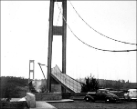 Side girder of the Tacoma Narrows Bridge rising whle roadbed falls during collapse as viewed from...