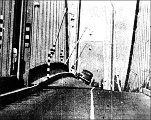Film still showing car tilting to the right on twisting Tacoma Narrows Bridge, November 7, 1940