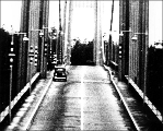 Film still showing car on the roadway during the Tacoma Narrows Bridge collapse, November 7, 1940