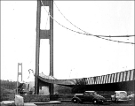 Side girder rising as the midsection falls during the collapse of the Tacoma Narrows Bridge,...