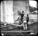 Attaching a cable to the foundation of a tower, Tacoma Narrows Bridge construction, ca. 1939