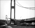 Side girder rising while roadbed falls during collapse of the Tacoma Narrows Bridge as viewed from...