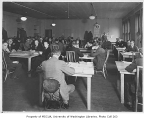 Office interior showing workers at tables, probably in King County, 1932