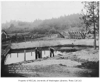 Bothell School water pool and athletic field showing laborers setting posts, Bothell, September 6,...