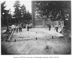 Construction workers and surveyors preparing a driveway outside Firland Sanatorium, Shoreline,...
