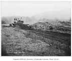 Bulldozer moving dirt during airport construction, Preston, August 13, 1934