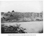 Firewood yard showing workers loading trucks near North 90th Street and Fremont Avenue North,...