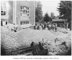 Construction workers preparing concrete for paving work outside Firland Sanatorium, Shoreline,...