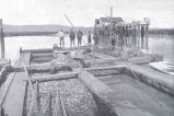 Large Double Float with Scows, Tongs, Baskets, and Other Features of the Oyster FisheryM. B....