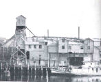 Large Oyster House at Providence, R. I., Showing Dredge Boat Unloading Oysters at Right and...