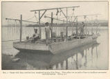 Barge with long crowfood bars, employed on the Ohio River. Note rollers set on ends of bars to...