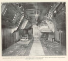 Interior view of fish transportation car, showing rows of covered tanks where fish are carried and...